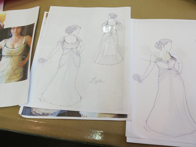 architectural and romatic wedding dress sketches taped with edits and changes