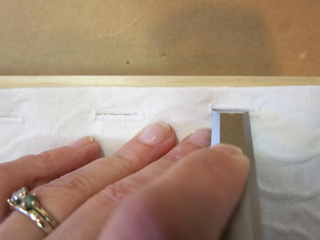 chiseling the buttonholes