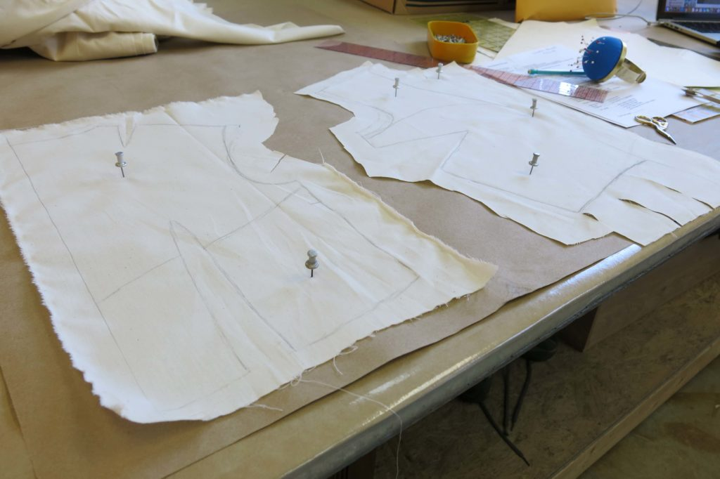 The rough drape pinned to the table ready for Patternmaking for Cameron's custom wedding overdress by Brooks Ann Camper Bridal Couture