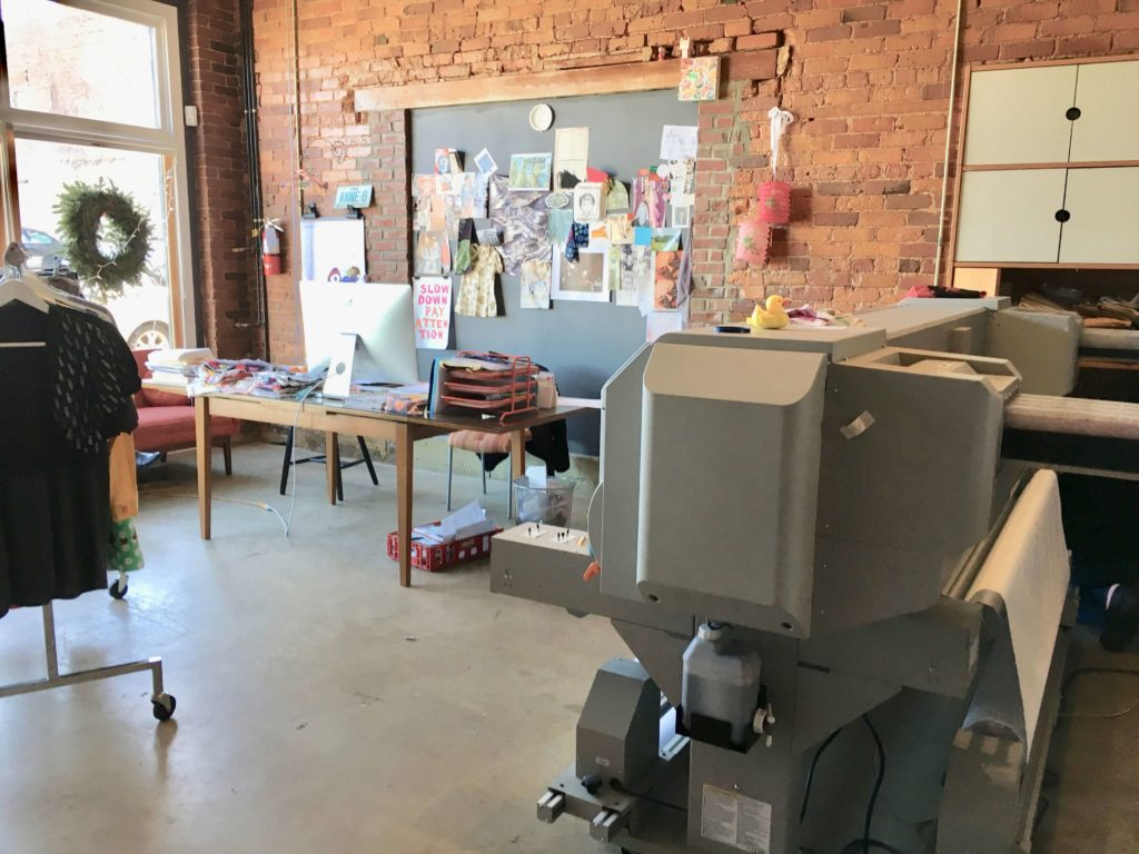 Anne's desk and one of the fabric printers at Red Canary | Brooks Ann Camper Bridal Couture