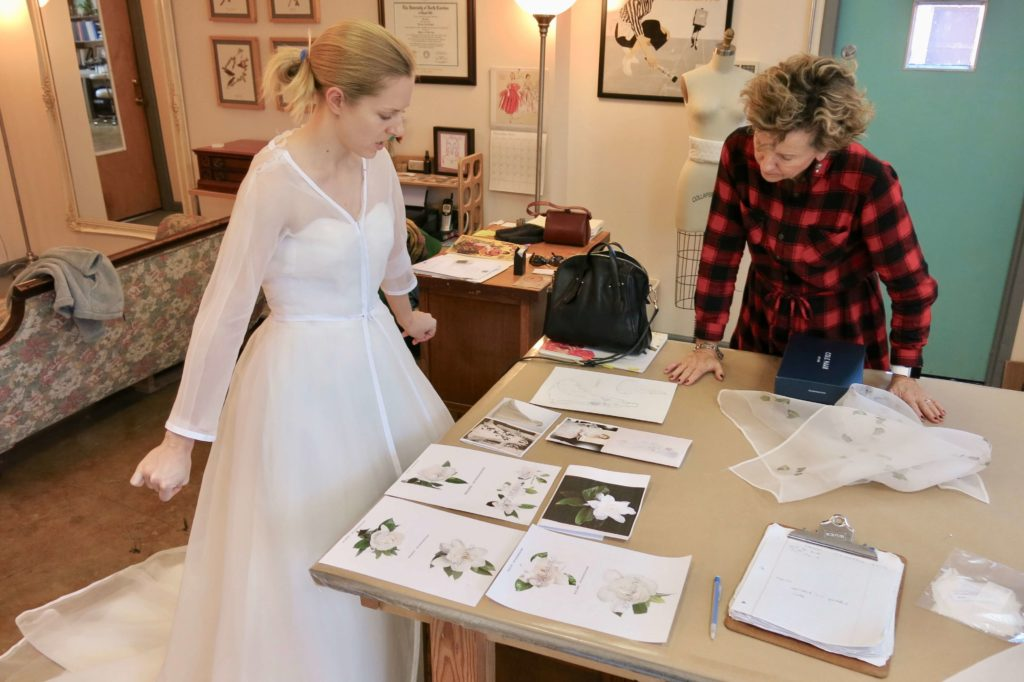 Looking at fabric samples during Cameron's first mockup fitting with Brooks Ann Camper Bridal Couture