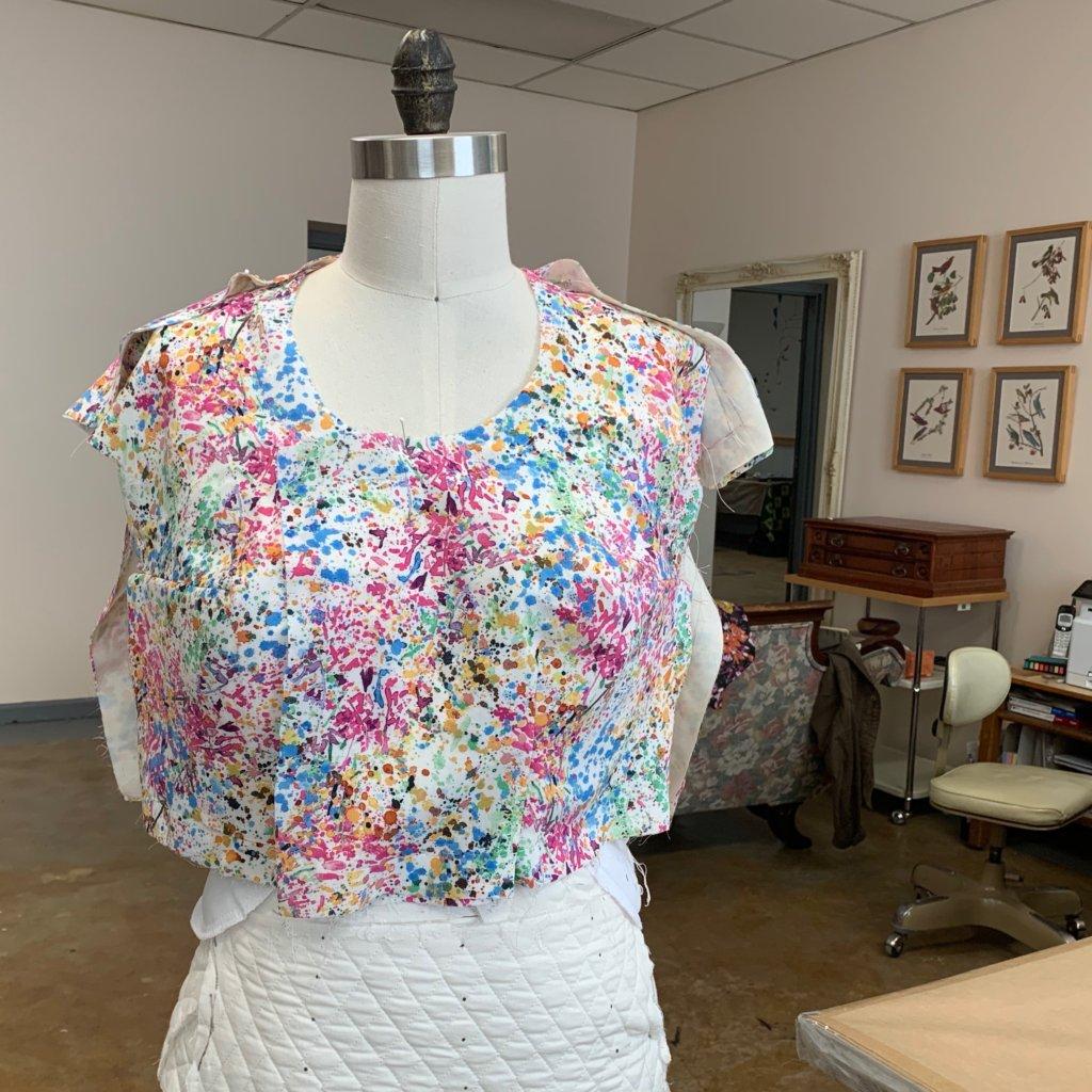 Dress progress pinned to a dress form