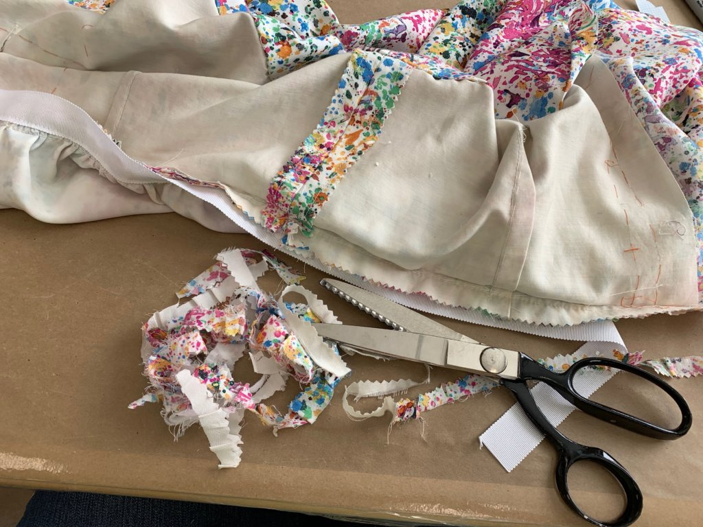 Trimming the waist seam allowance with pinking shears